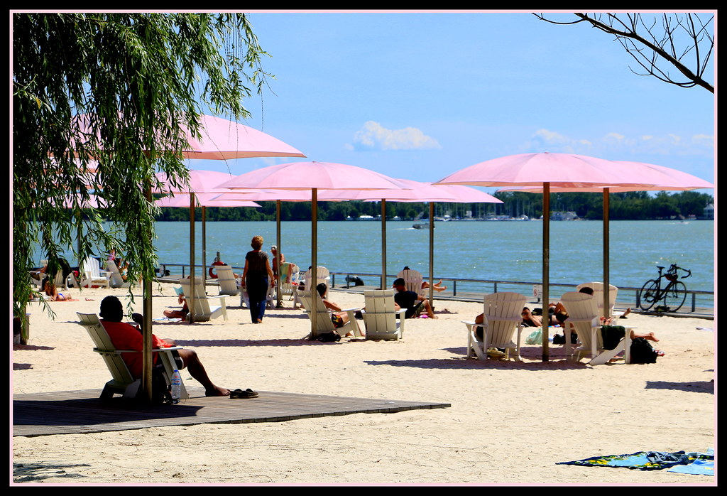 People relaxing at Sugar Beach on the Toronto Waterfront.