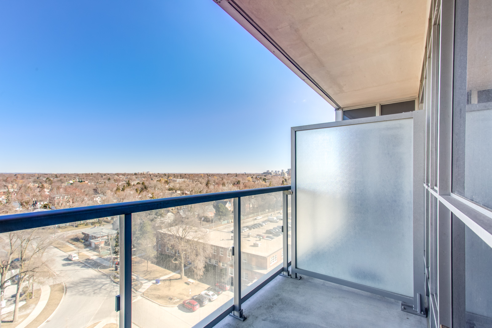 Photo of 120 Harrison Garden Unit 1025 balcony and its glass panels.