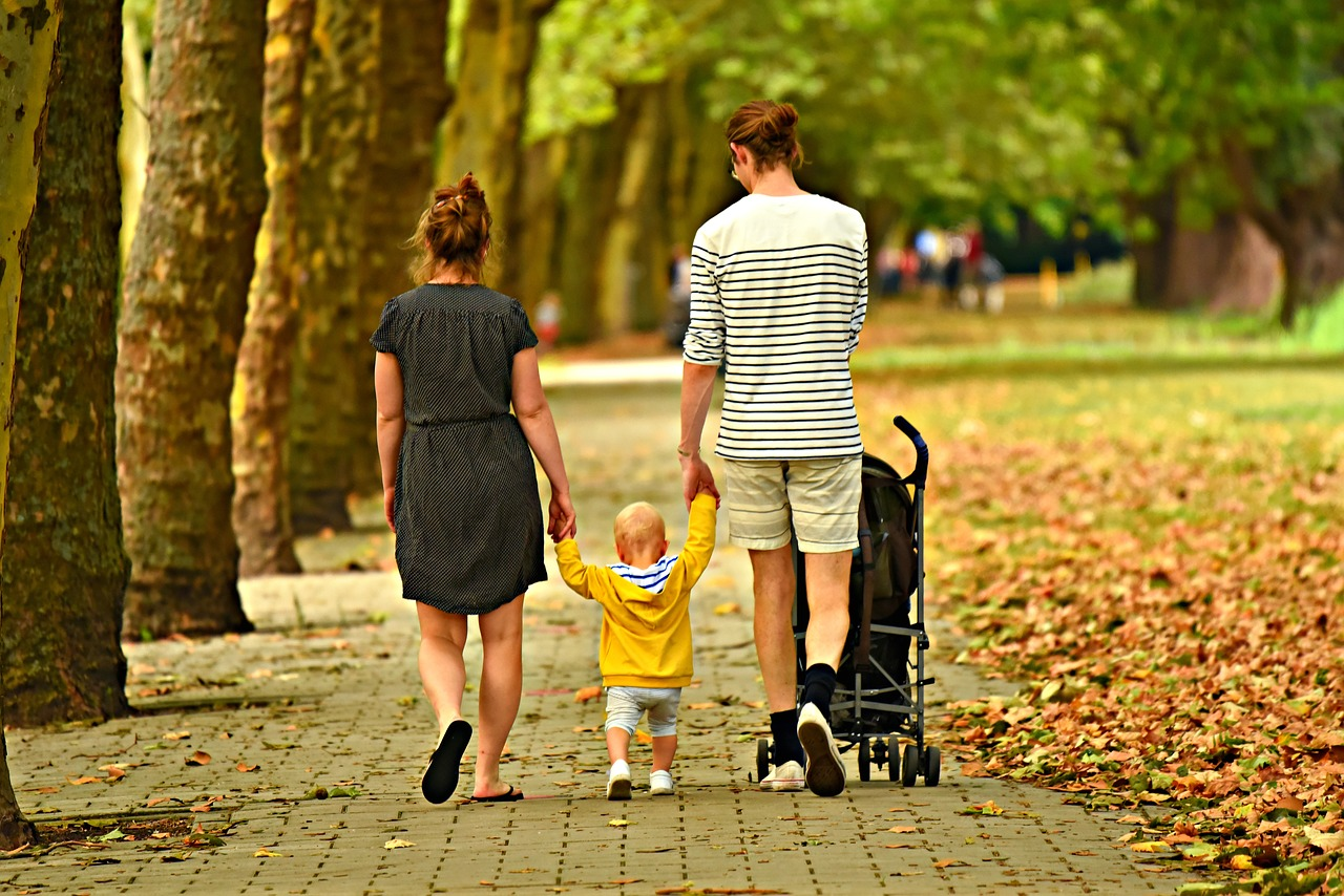 Photo of couple and their child at park.