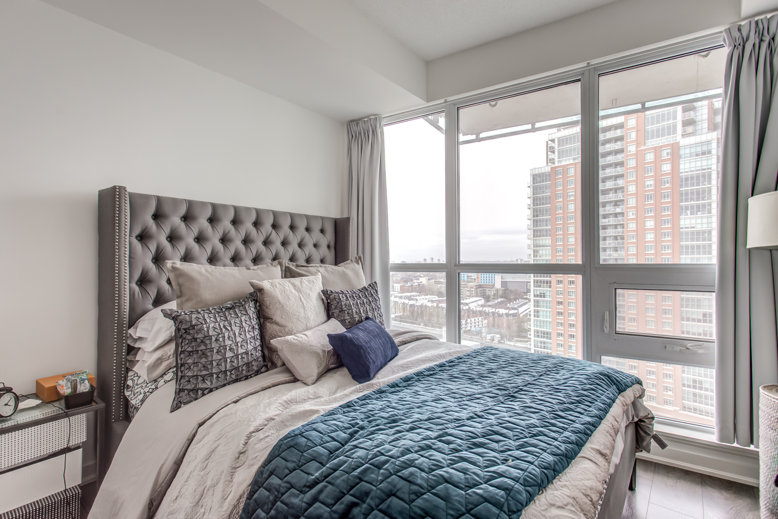 Bedroom and large windows of 150 East Liberty St Unit 1616.