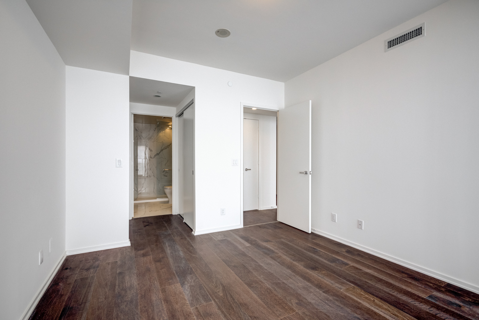 It has the same hardwood floors, huge windows and an ensuite bath.