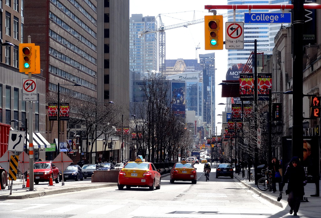 Image of Yonge and College Street in Toronto during day time.