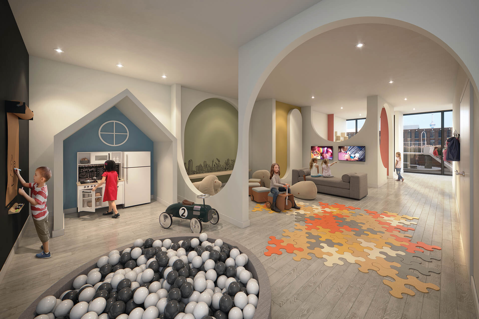 Kid's play room with ball pit and other areas at XO Condos.