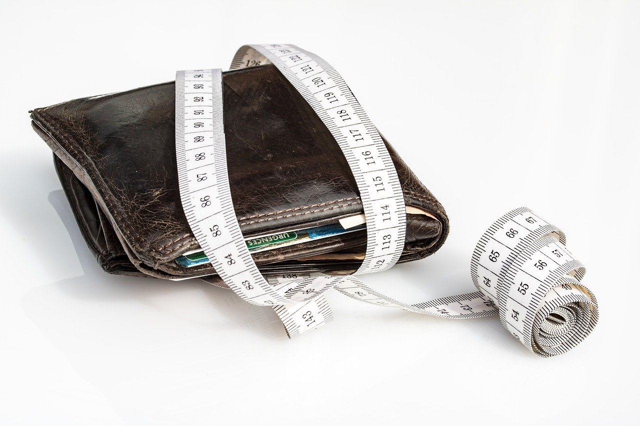 Pre-Listing Tip for sellers about budget and estimates with wallet and measuring tape.