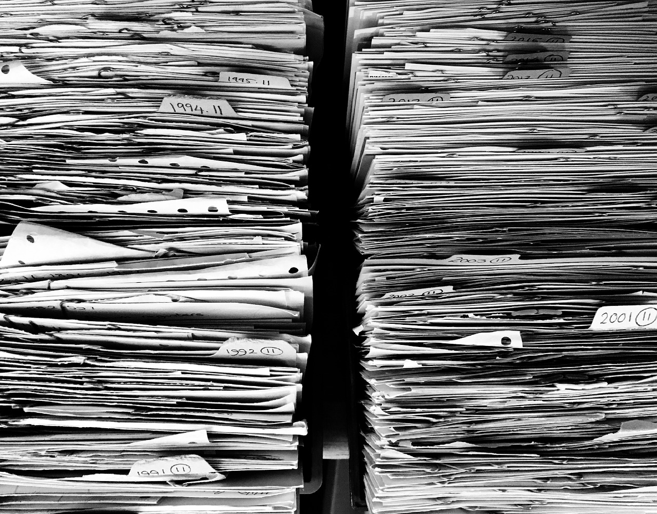 2 huge stacks of papers showing next pre-listing tip for sellers and importance of having all paperwork ready.