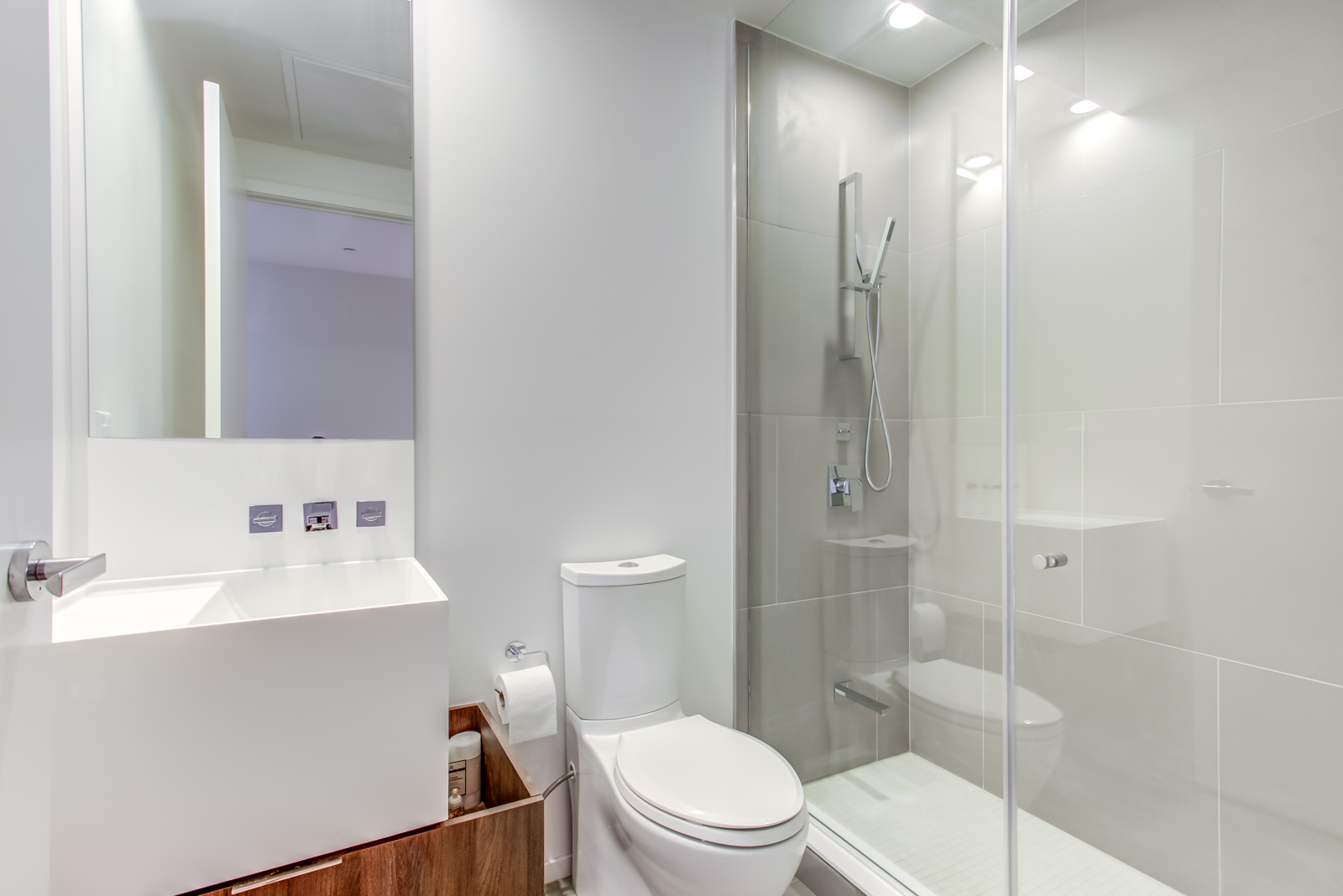 Sink, toilet and walk-in shower of 1 Bloor St E Unit 3408's second bathroom.