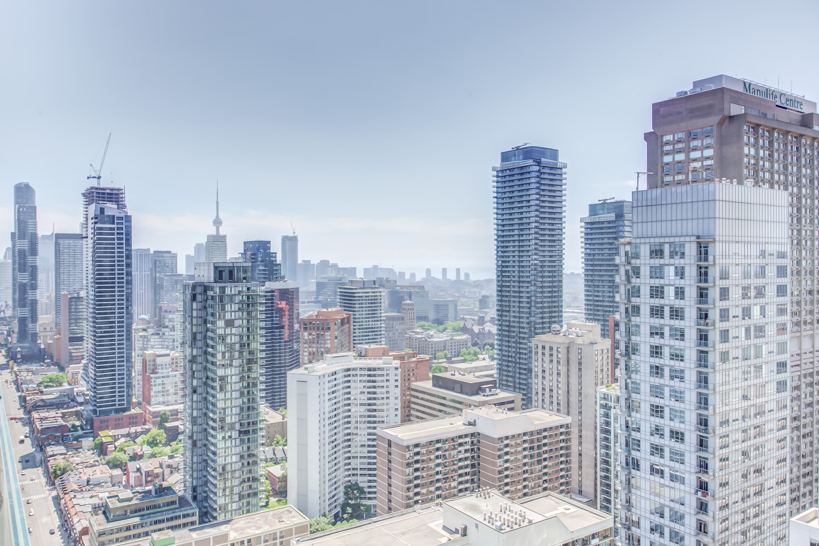 Ariel view of Yonge and Bloor from balcony of 1 Bloor St E Unit 3408.