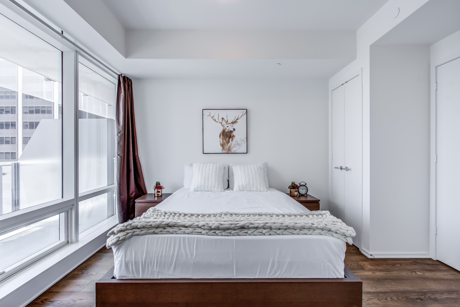 Master bedroom and bed of 1 Bloor St E Unit 3408.
