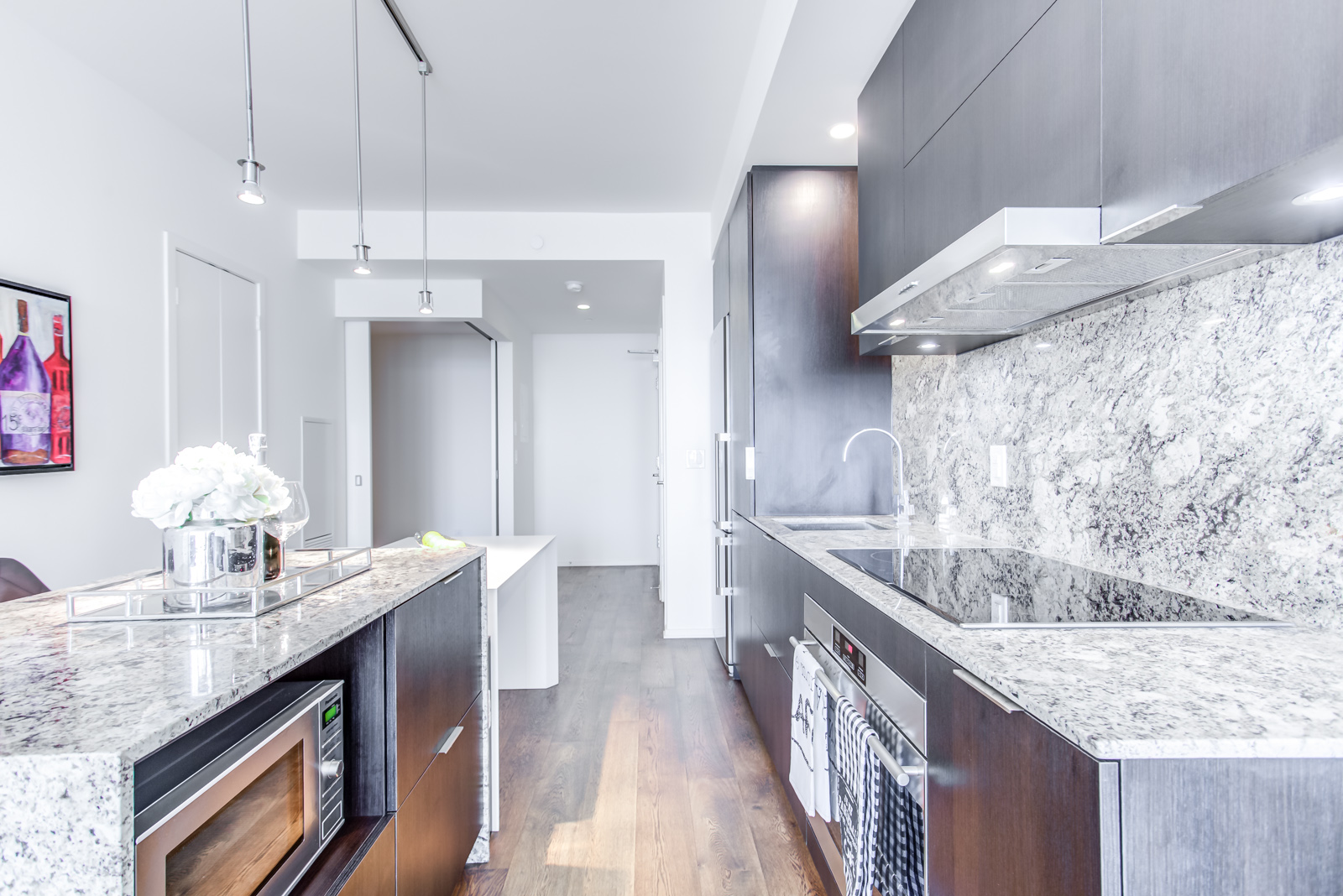 Granite island and kitchen from another angle - 1 Bloor St E Unit 3408.