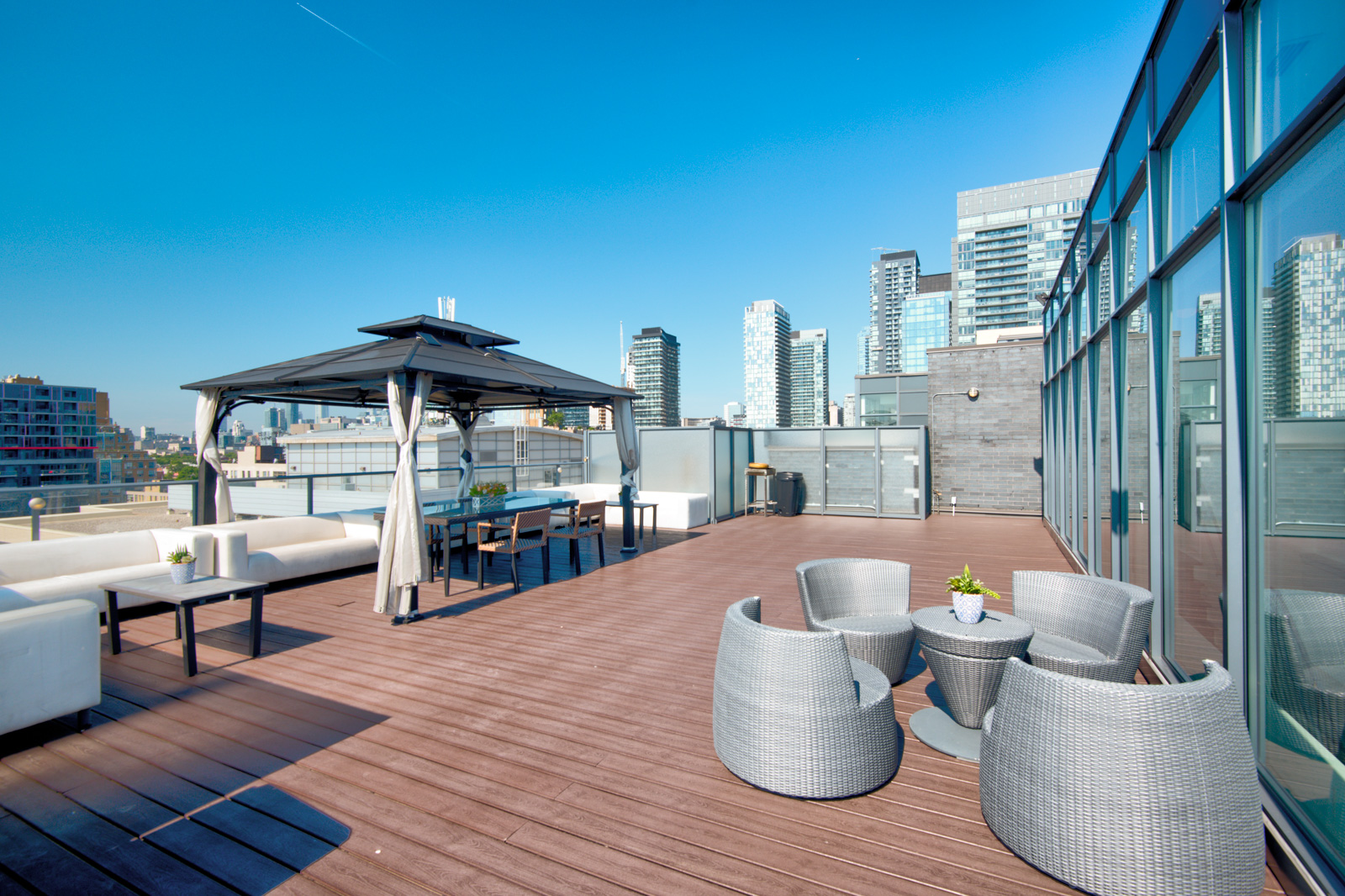 Terrace and deck with furniture - Victory Lofts Penthouse Suite in 478 King St W Toronto.