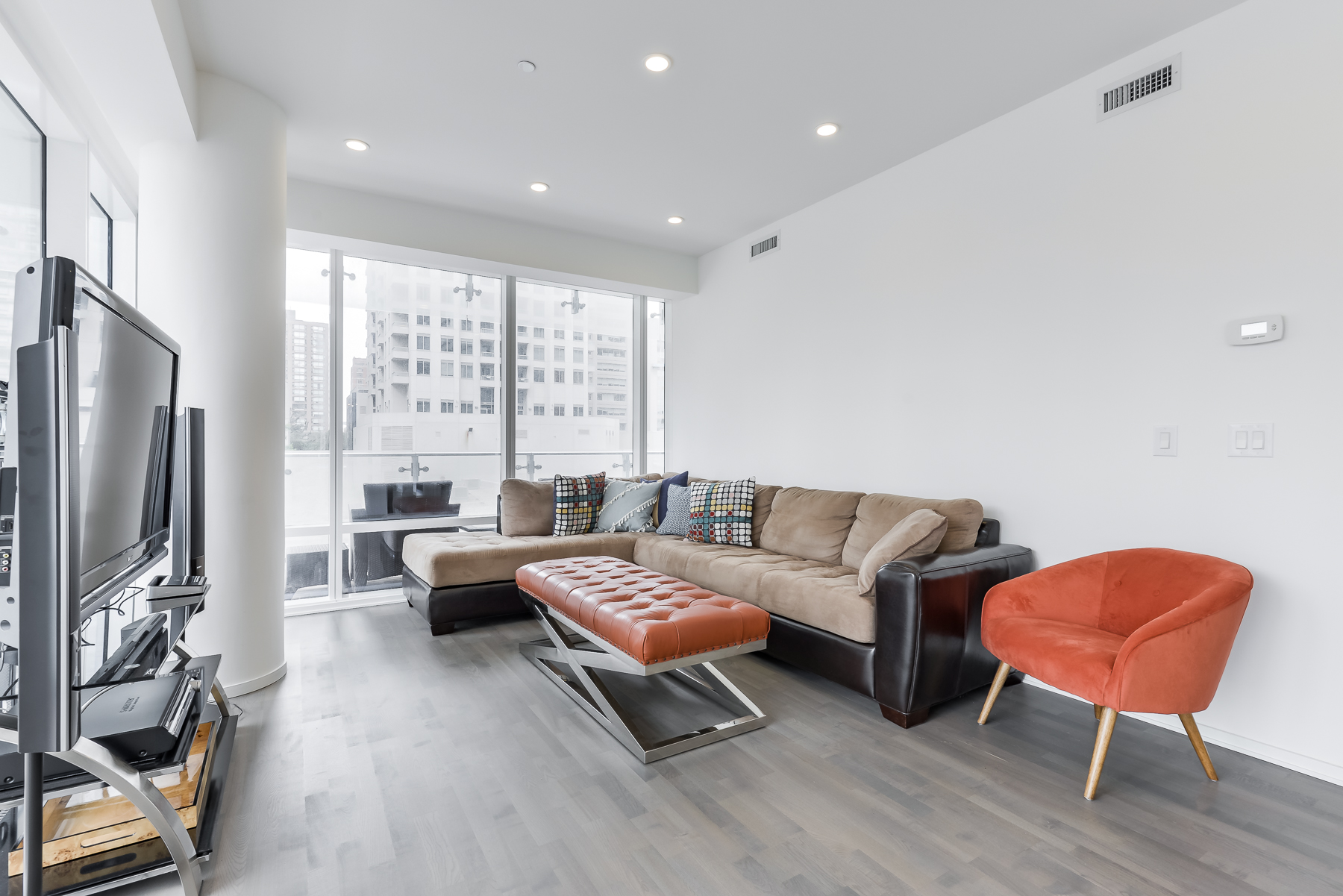 Fully furnished living room of 1 Bloor St E Unit 310 Toronto.