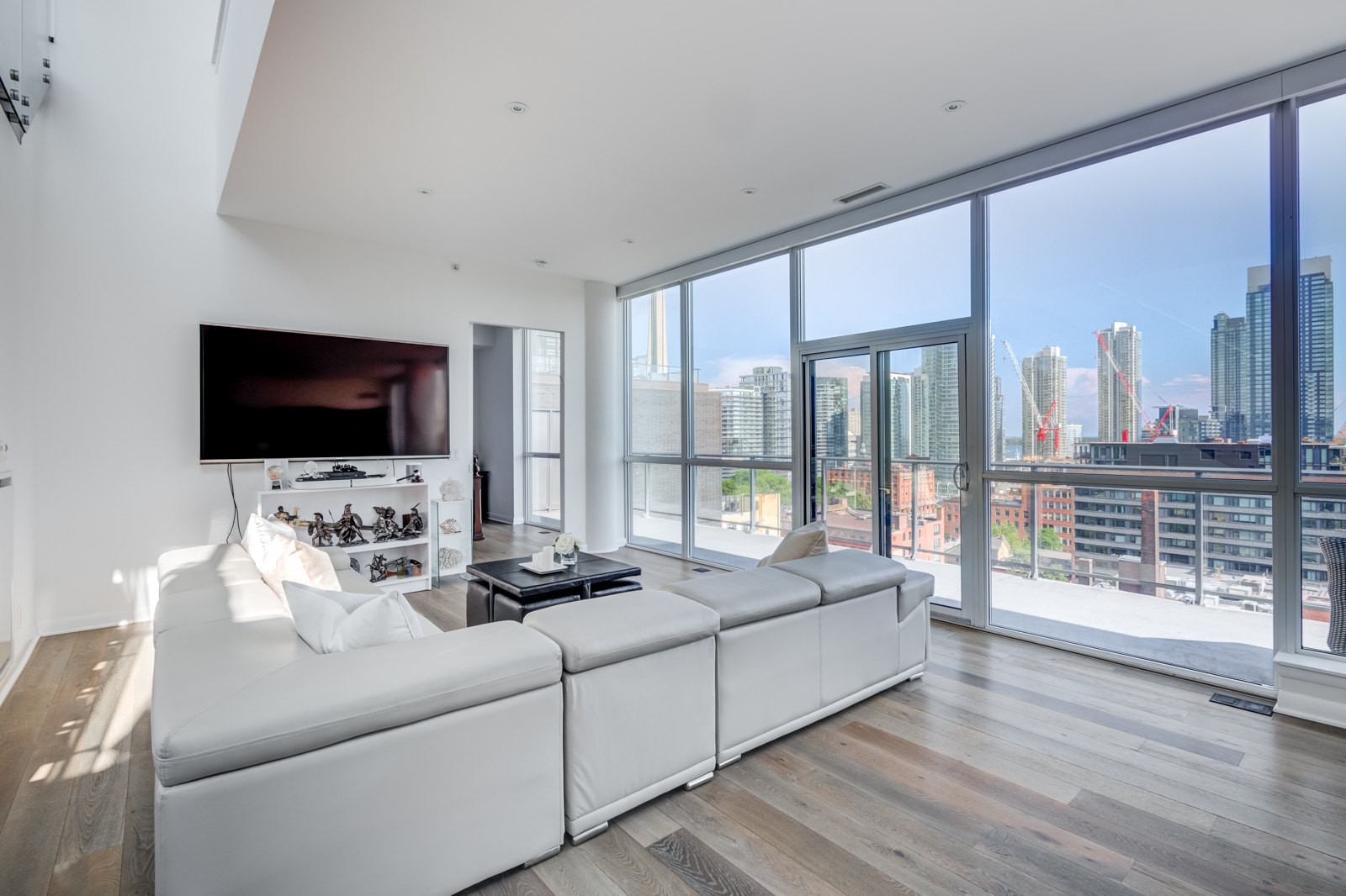 Open concept living room with furniture and windows - Victory Lofts Penthouse Suite in 478 King St W Toronto.