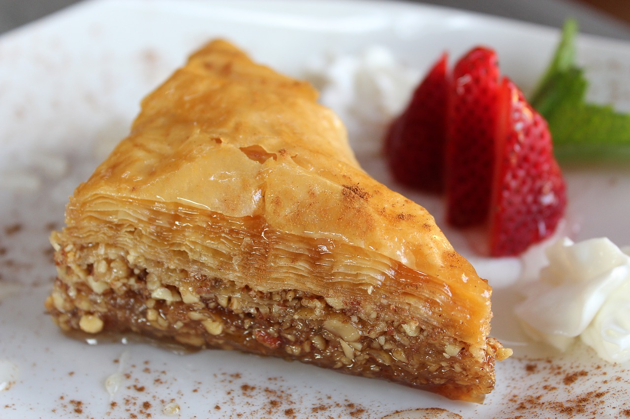 Greek baklava on a plate with strawberries.