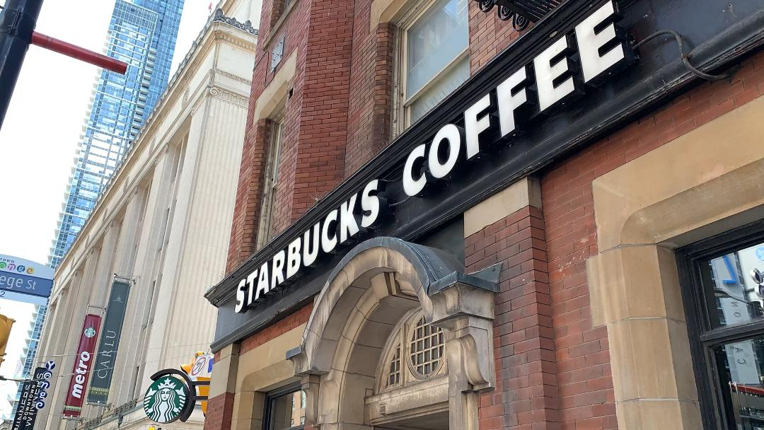 Starbucks sign over store in Yonge and Dundas Toronto.