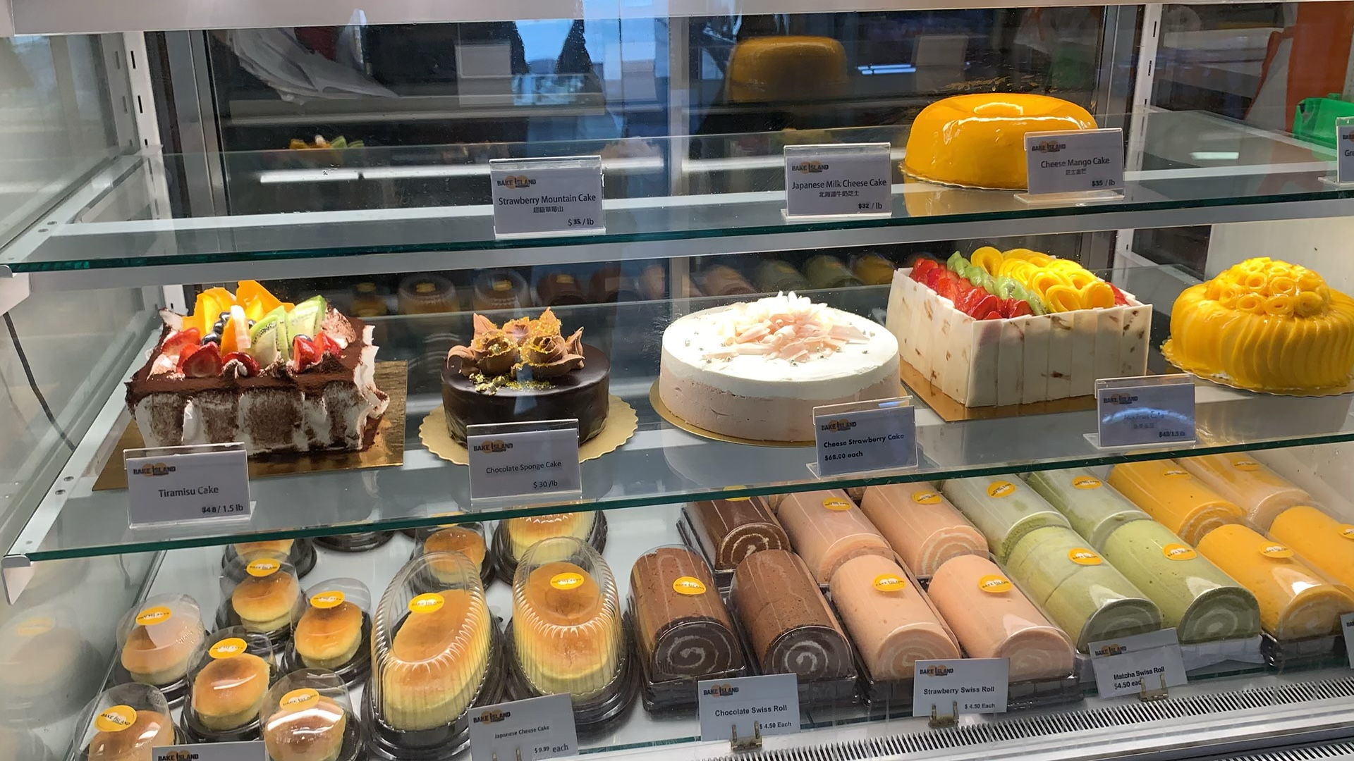 Store display with colourful desserts at Bake Island in Yonge and Dundas.