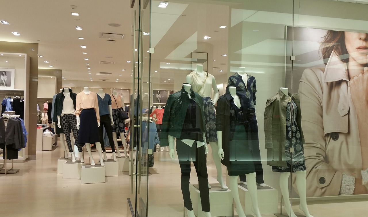 Store display of women's fashion with mannequins.