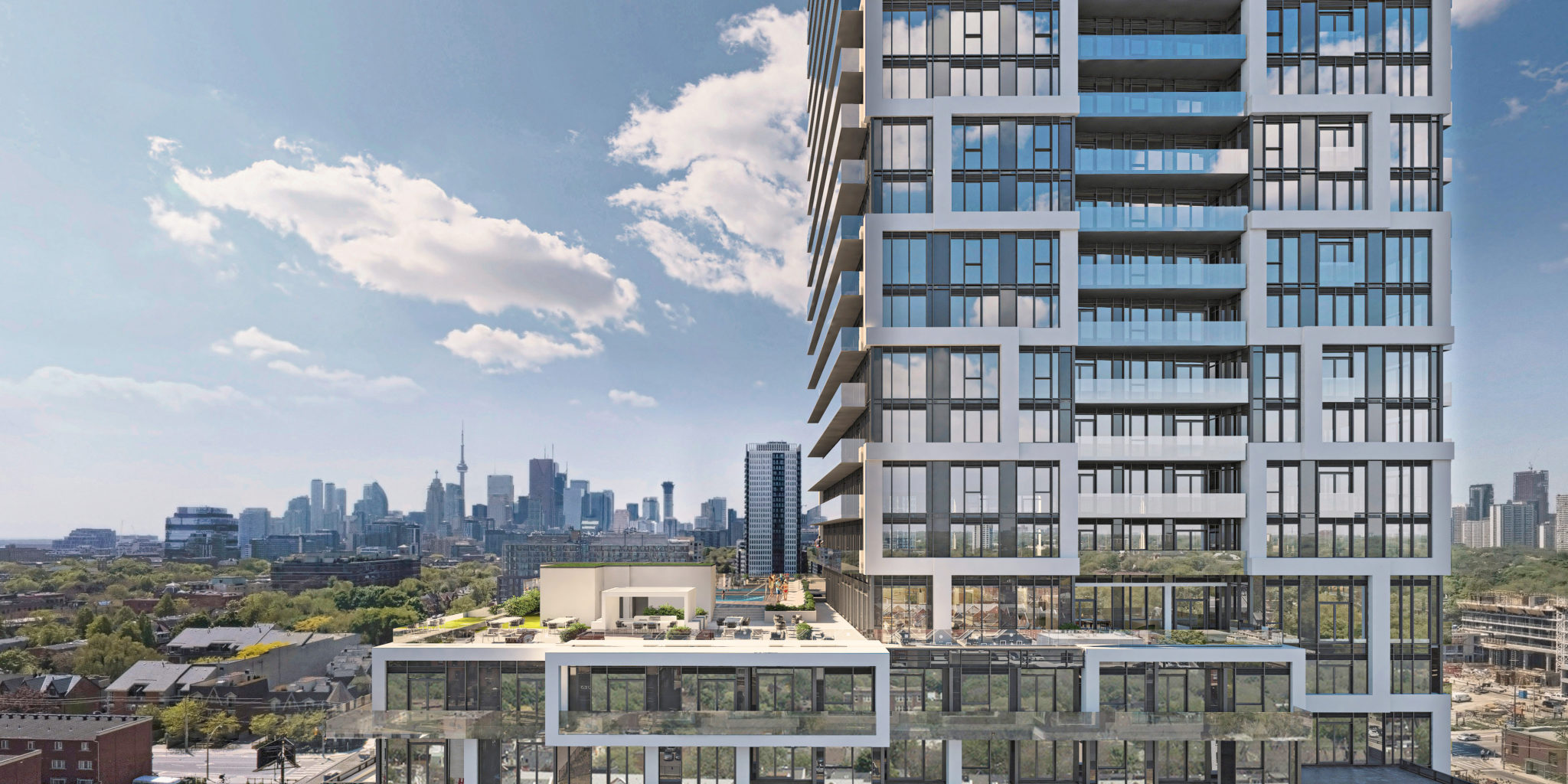 A close-up of River and Fifth Condos on 5 Deffries St with Toronto and CN Tower in background.
