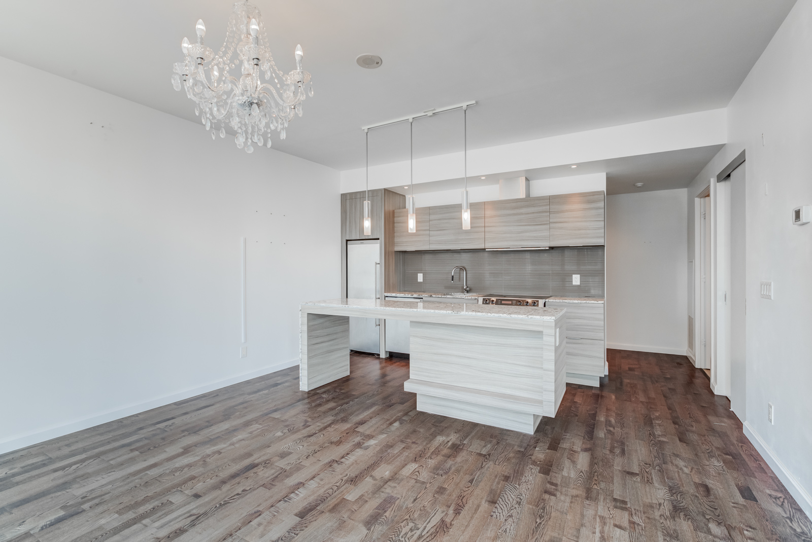 8 Charlotte St Toronto Unit 1508 open-concept living and dining room with kitchen.