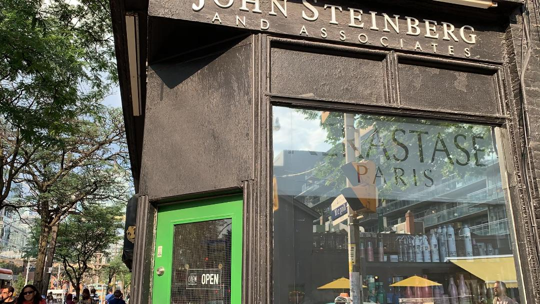 Brick exterior of John Steinberg & Associates hair salon on King West, Toronto.