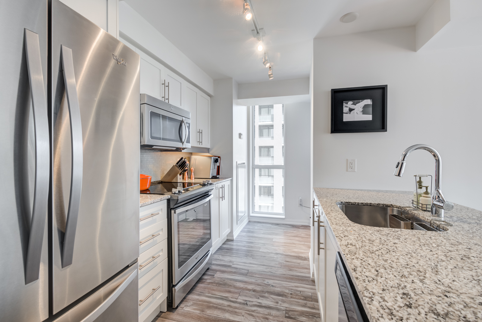 Kitchen and window view of 400 Adelaide St E Unit 704 condos in Moss Park.