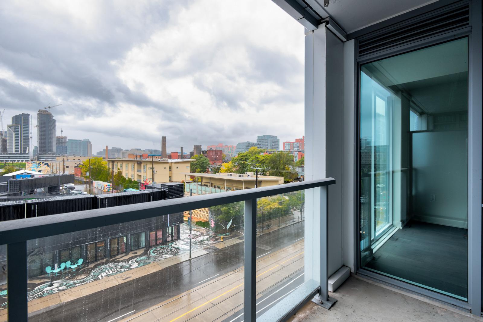 Balcony of Minto Condos overlooking Bathurst St, Toronto on a rainy day.