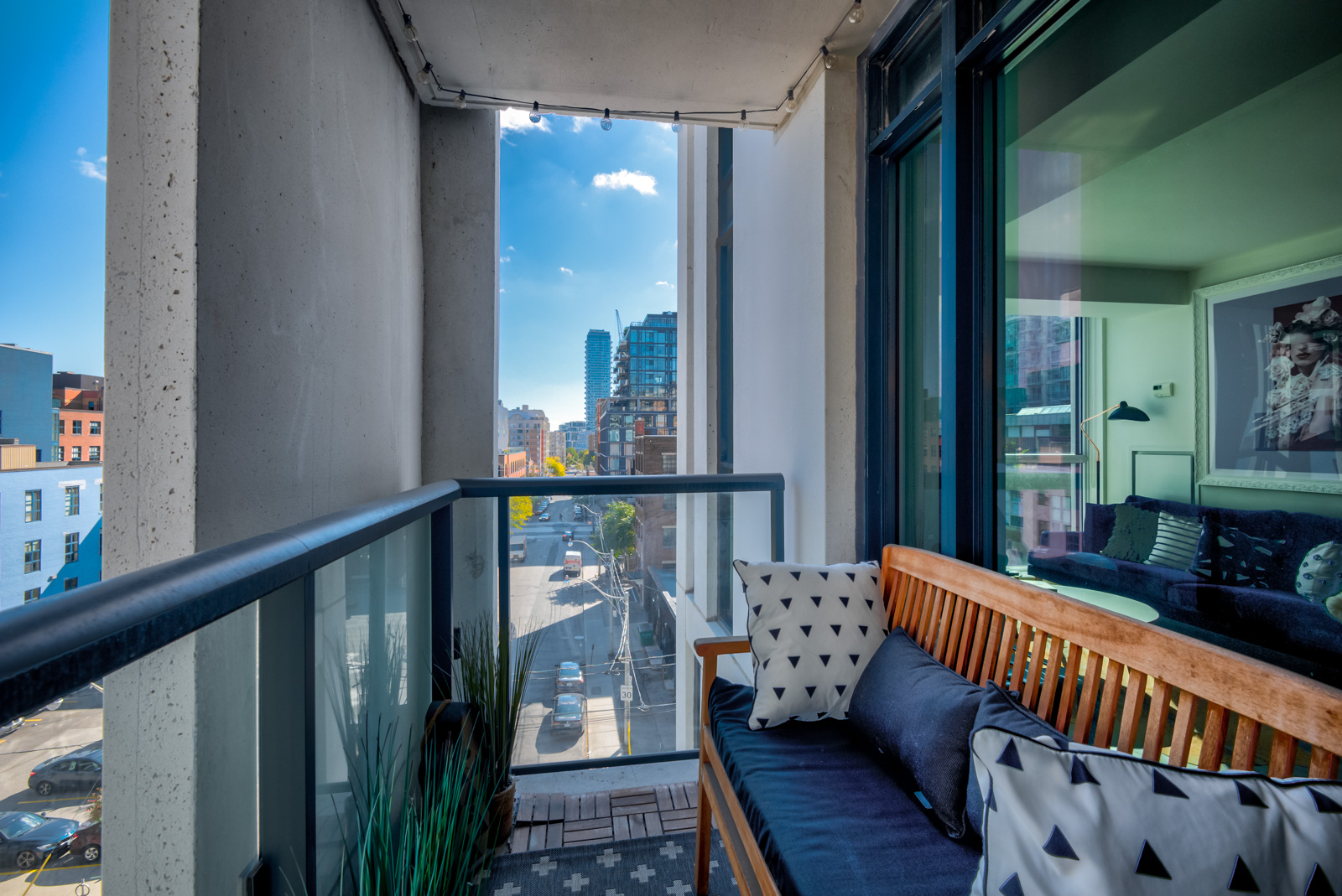 Balcony with glass-panels and bench at Ivory condos.