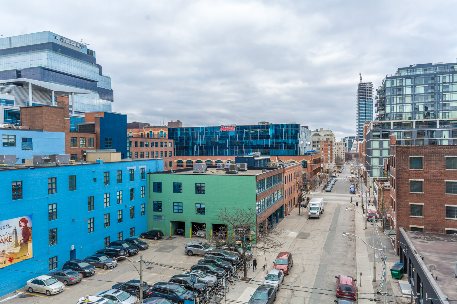 Balcony view from Ivory Condos of Sherbourne and Adelaide St in Moss Park with blue and green buildings.