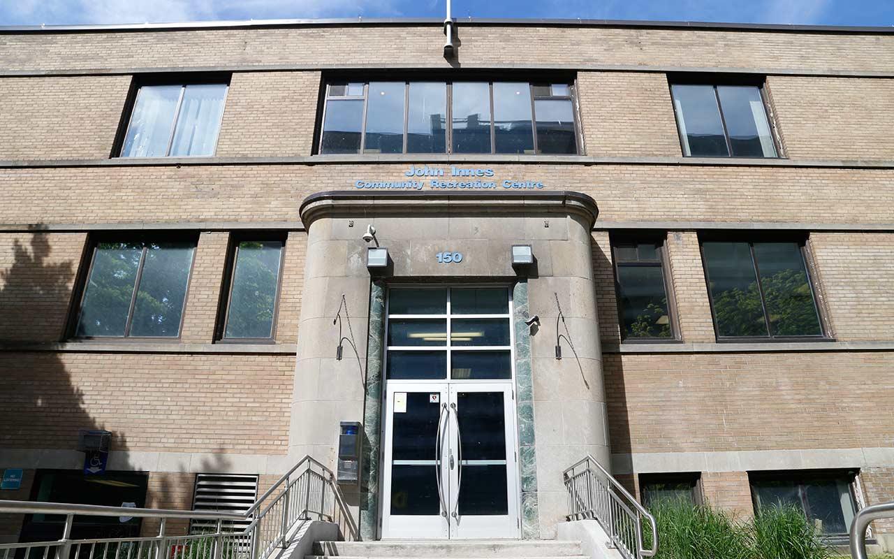 Brown exterior of John Innes Community Centre on 150 Sherbourne St.