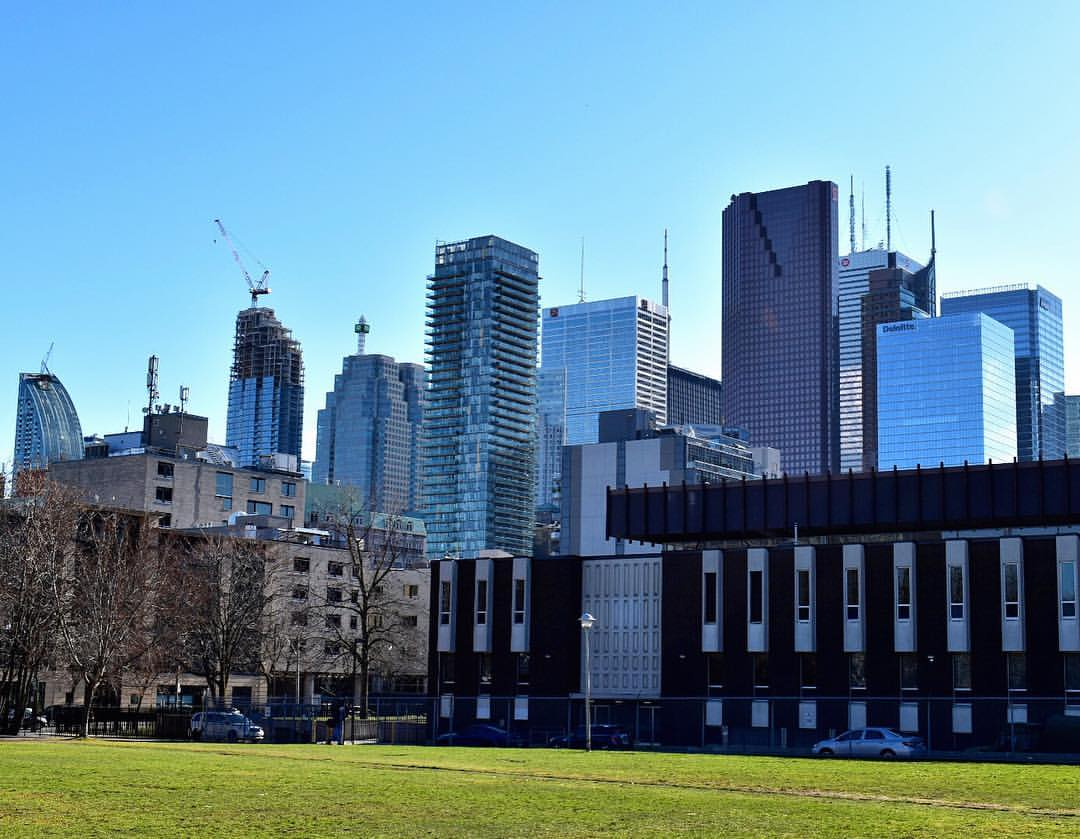 Construction of condos in Toronto's Financial District seen from Moss Park.