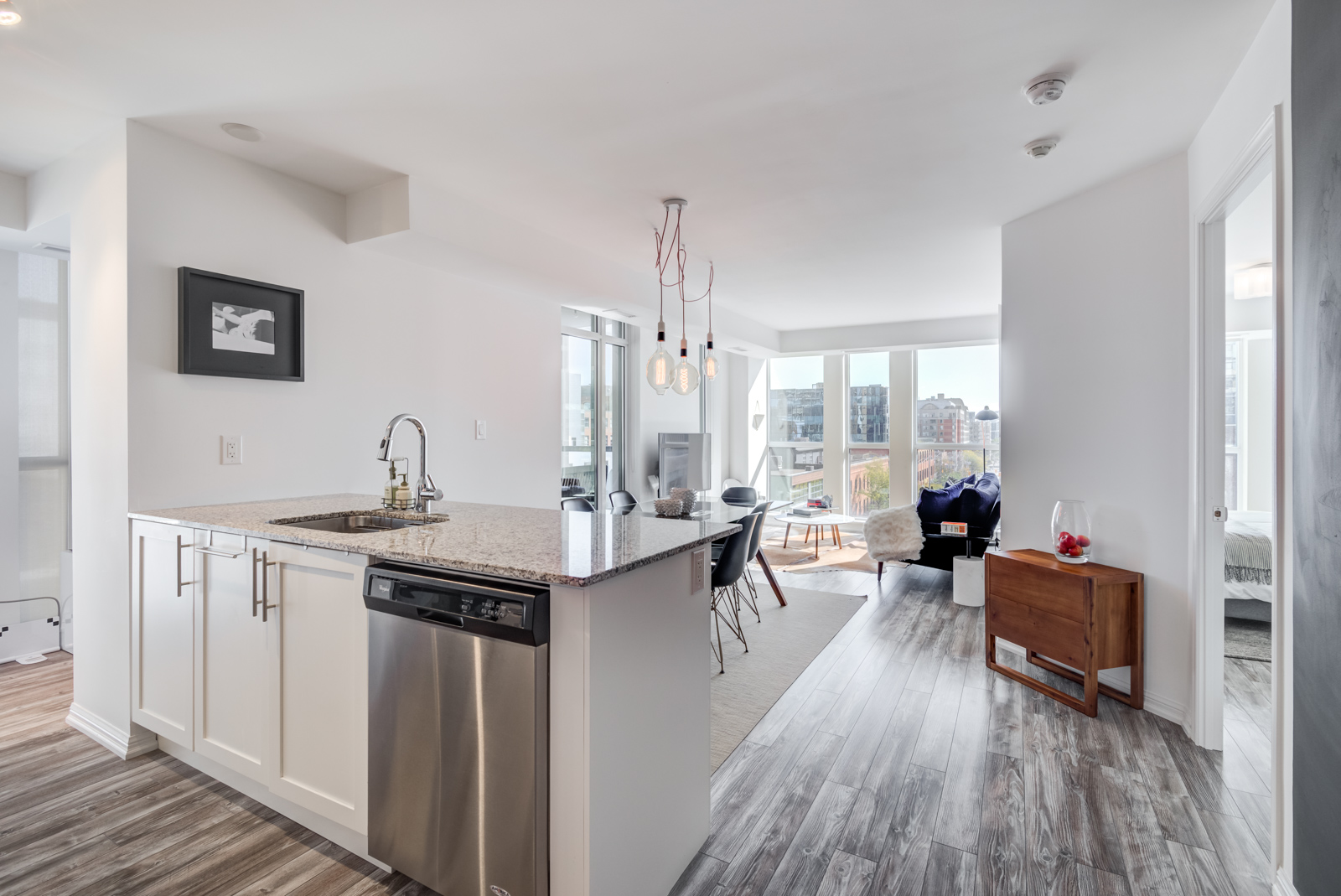 400 Adelaide St E Unit 704 Moss Park; condos kitchen, living room and dining room with laminate floors.