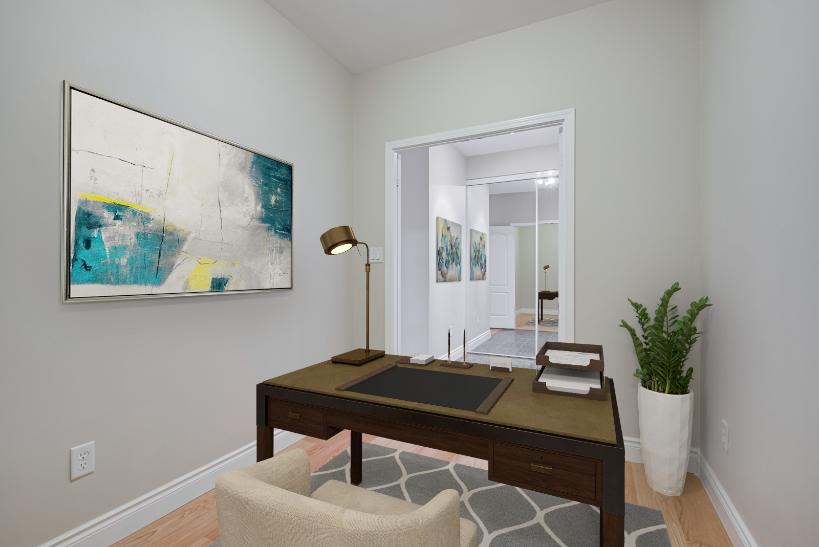 Condo den with 3d rendered desk, lamp and painting.