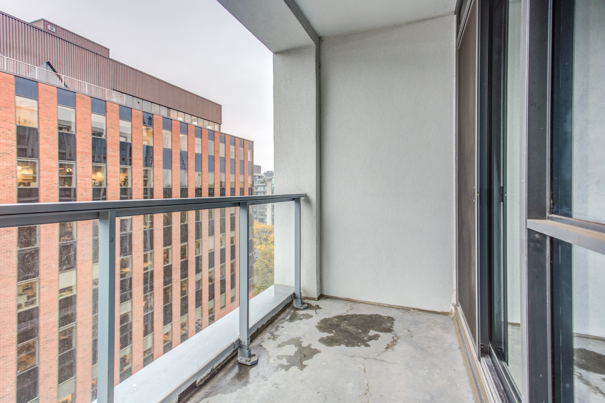 Balcony of 39 Brant St Unit 918, Brant Park Lofts, with glass-panels.