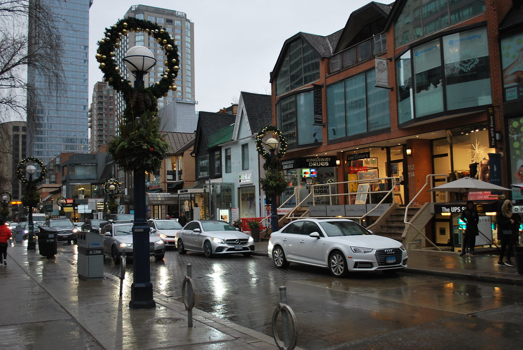 Rainy day and cars at Cumberland St in Yorkville, Toronto.