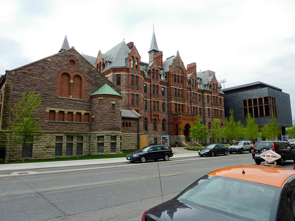 Across-the-street view of The Royal Conservatory of Music on 273 Bloor West; brown building and spires.