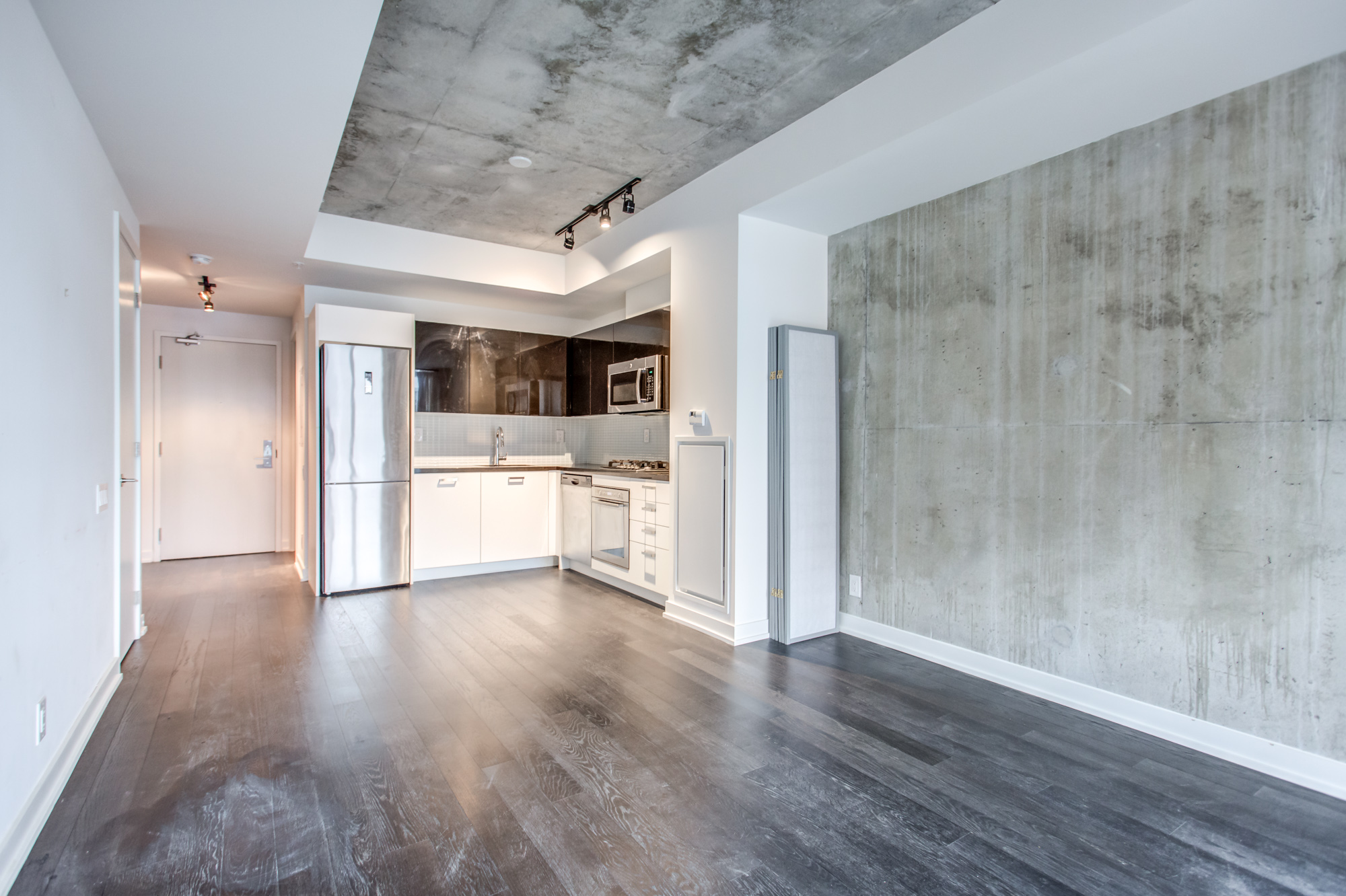 Spacious and empty condo unit at 39 Brant St Unit 918, Brant Park Lofts, in Queen West Toronto.