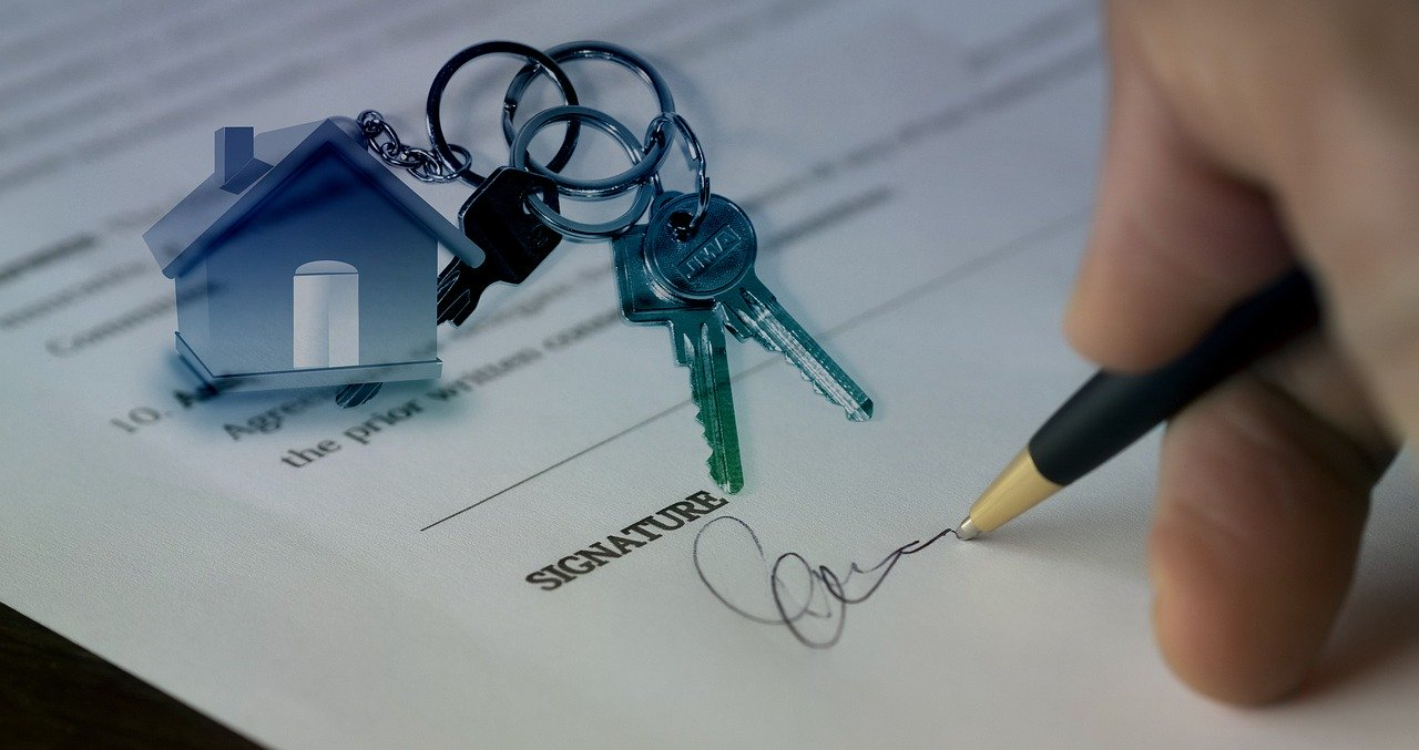 Hand signing contract for house