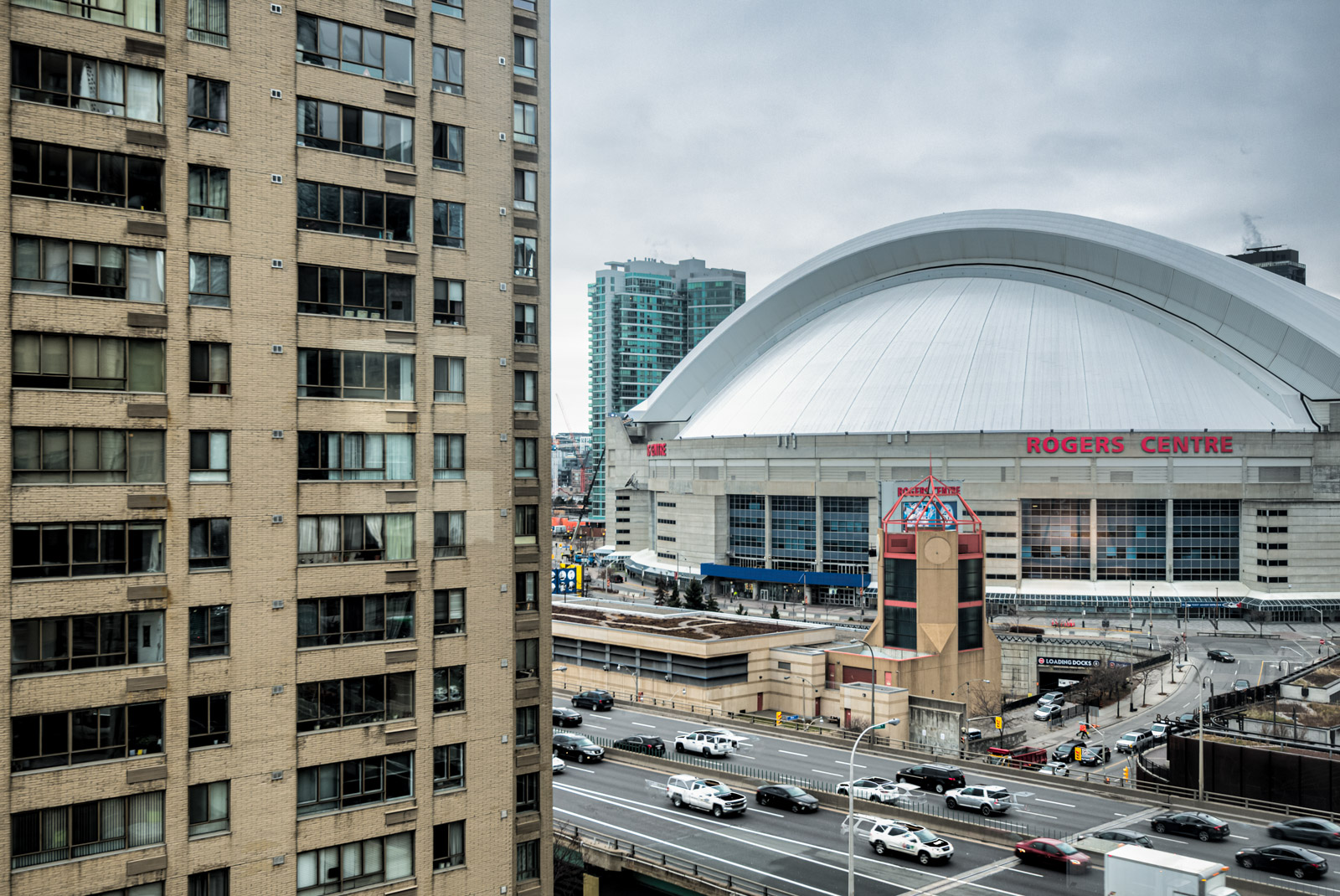 White-domed Rogers Centre, busy highway and buildings close to Harbourpoint II.