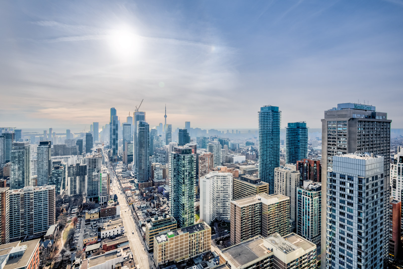 Morning; Toronto skyline showing CN Tower and streets of Yonge and Bloor.