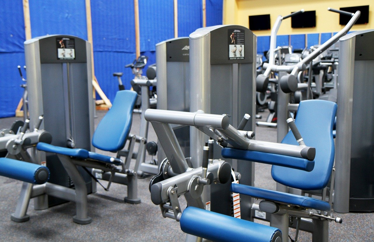Gym at Twenty Collier with multiple leg press and other equipment.
