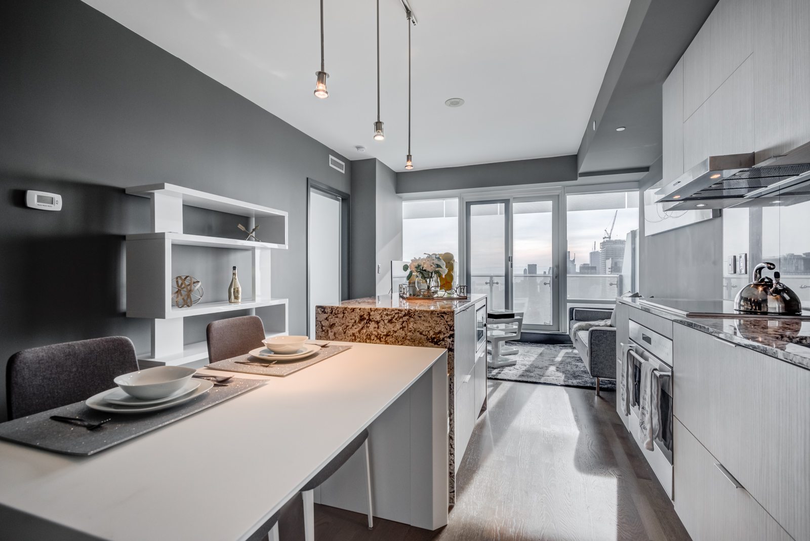 Condo kitchen with white island