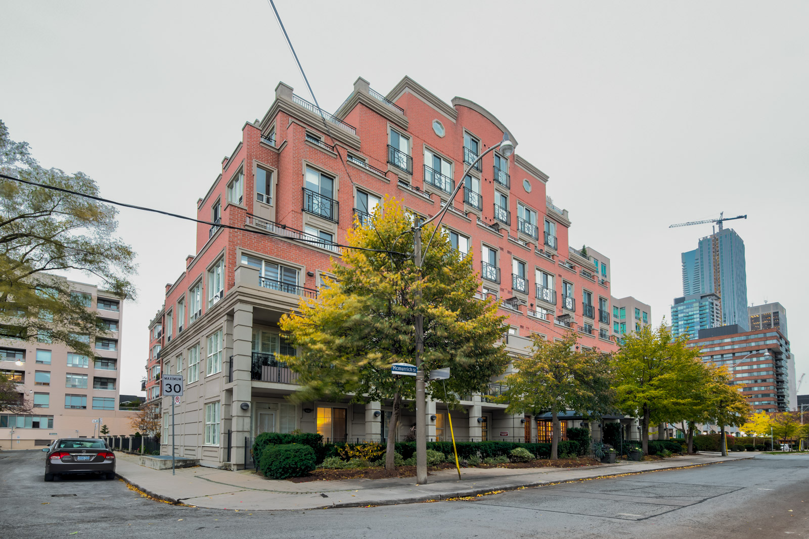 Boutique condo with red-brick facade of 77 Mcmurrich St Unit 308, Mcmurrich Residences, the fourth most expensive property.