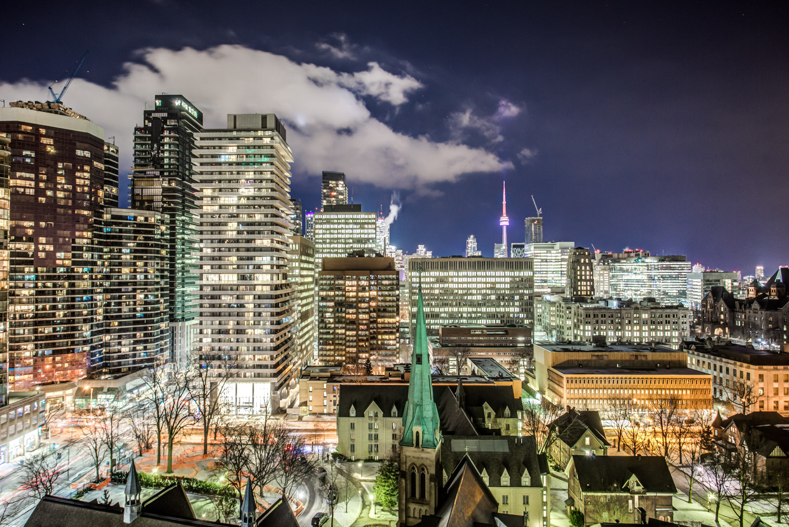 Night view of Toronto skyline from balcony of 5 St Mary St at U Condominiums.