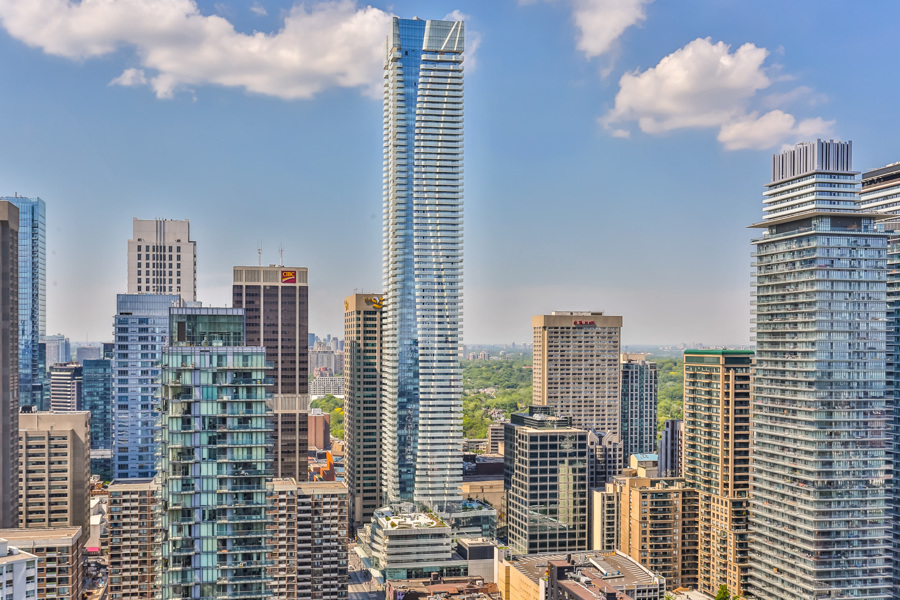 Toronto skyline, daytime, showing One Bloor Condos on 1 Bloor St E Unit 4905, the fifth most expensive property.