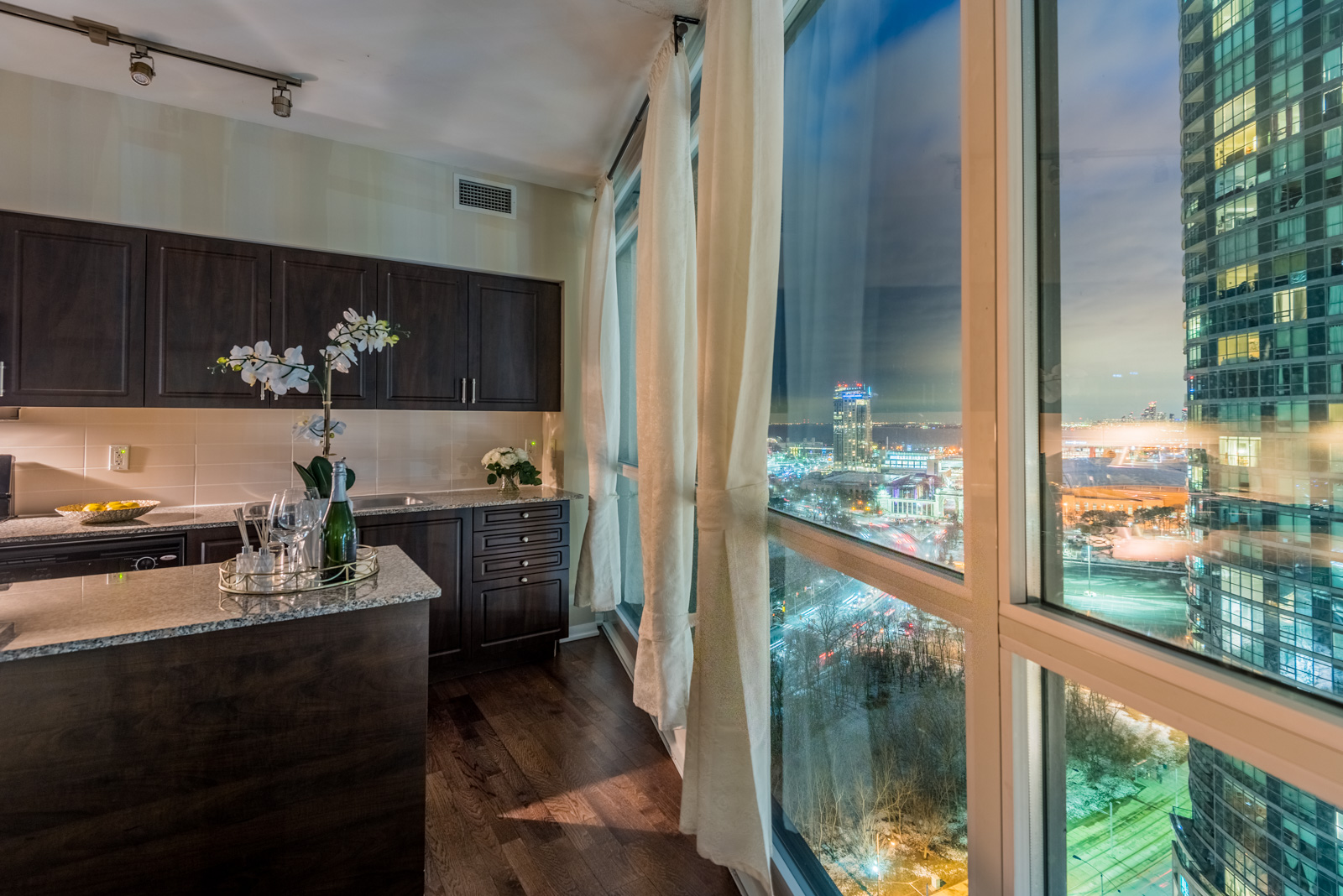 Night view of Fort York Toronto from kitchen of 215 Fort York Blvd Unit 2310.