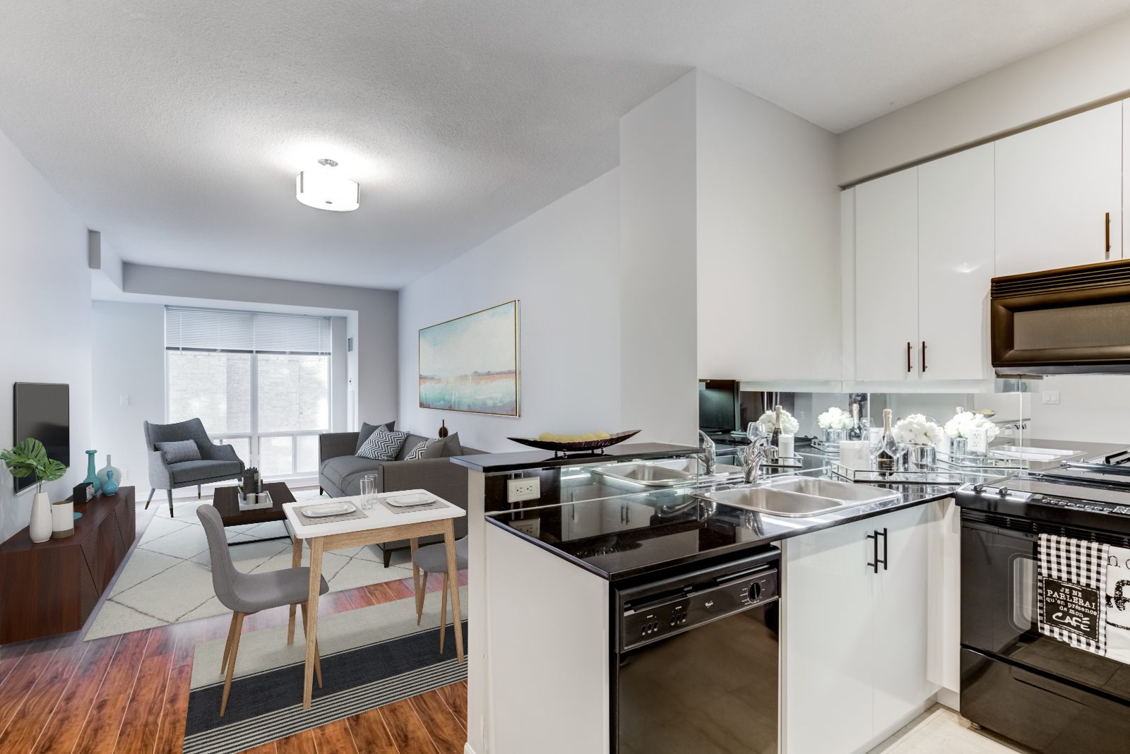 View of living and dining room of 300 Bloor St E Unit 1809 from kitchen.
