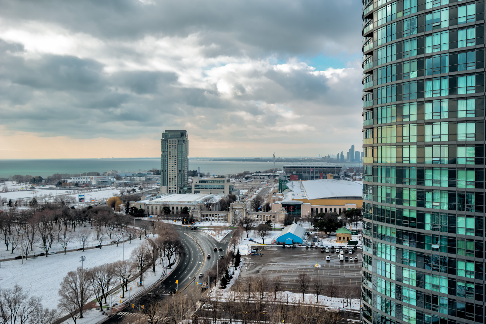 Daytime view of Lake Ontario and buildings from 215 Fort York Blvd balcony.