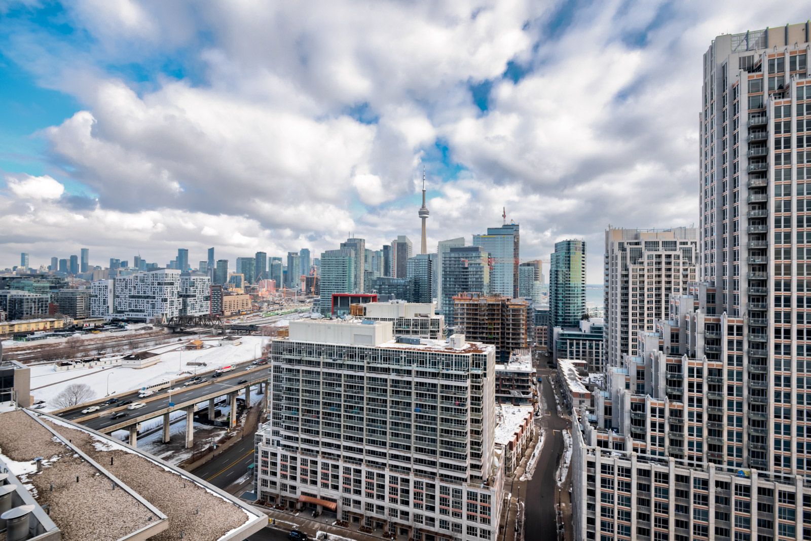 Daytime view of CN Tower and downtown Toronto from 215 Fort York Blvd Unit 2310 balcony.