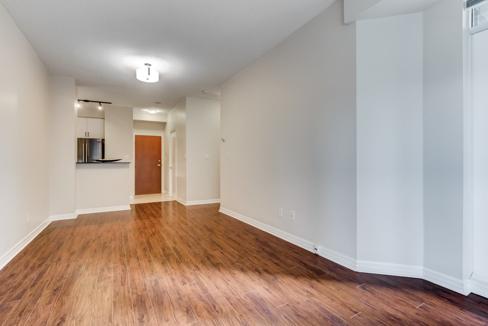 Empty condo living and dining room at 300 Bloor St E Suite 1809.