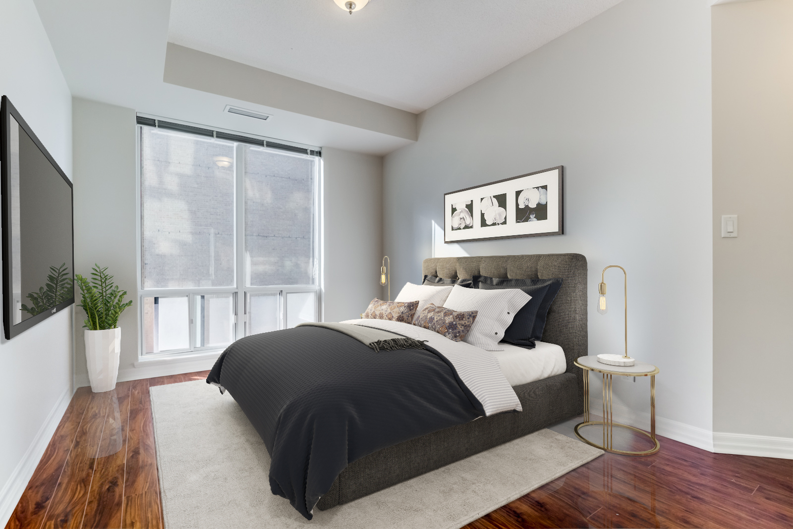 Master bedroom at 300 Bloor St E Unit 1809 with 3D rendered table lamp, carpet and bed with dark sheets.
