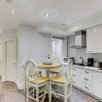 Renovated kitchen and dining room of 120 McGill St with brand new cabinets and appliances.